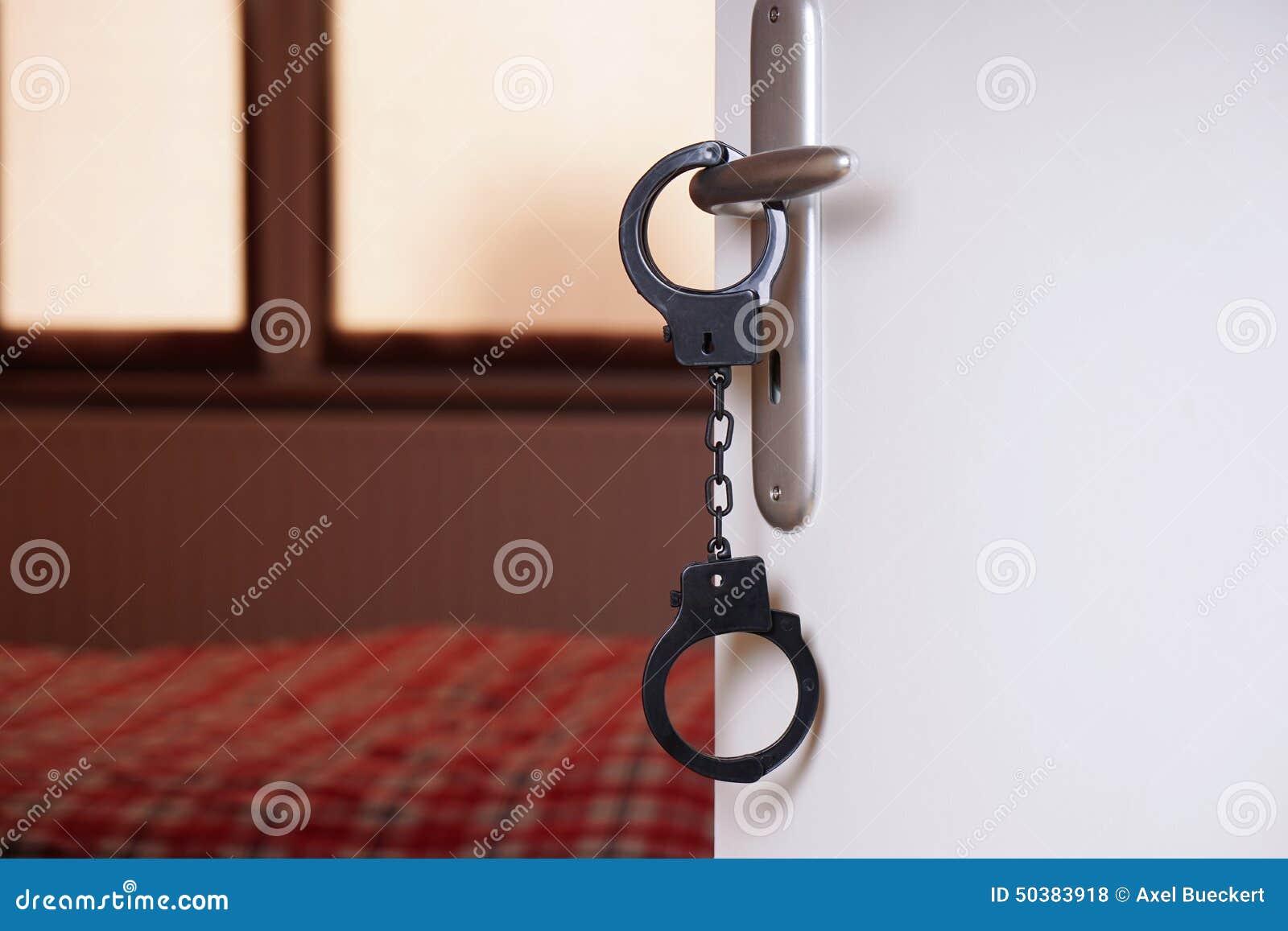 handcuffs on bedroom door handle stock photo image 50383918