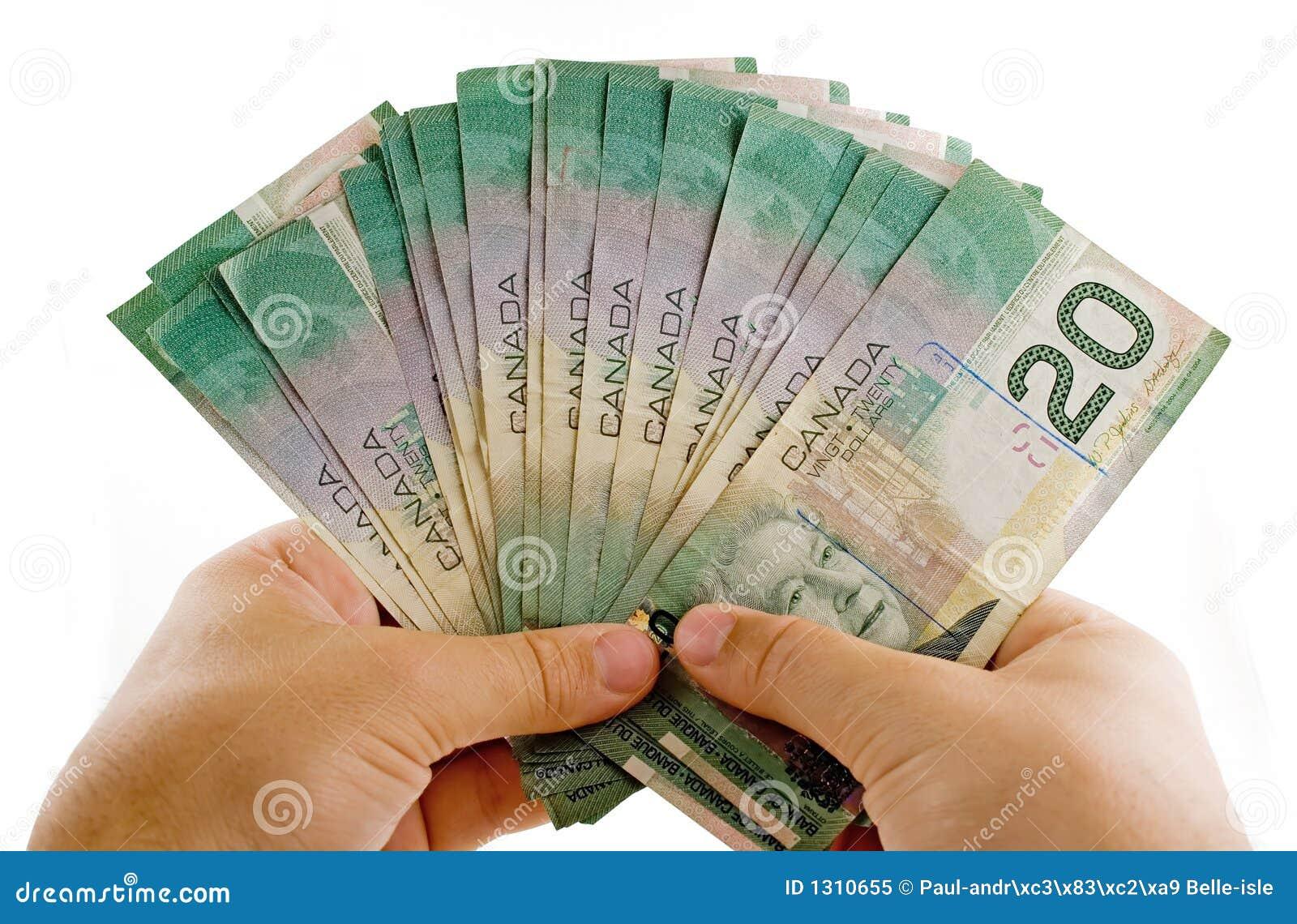 Handen met Canadese dollars