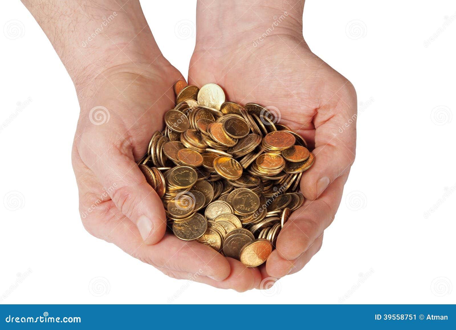 Handen met muntstukken