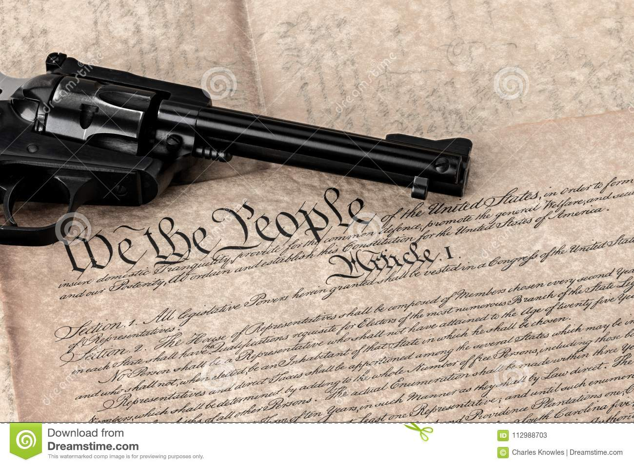 Handgun on a copy of the constitution in original font