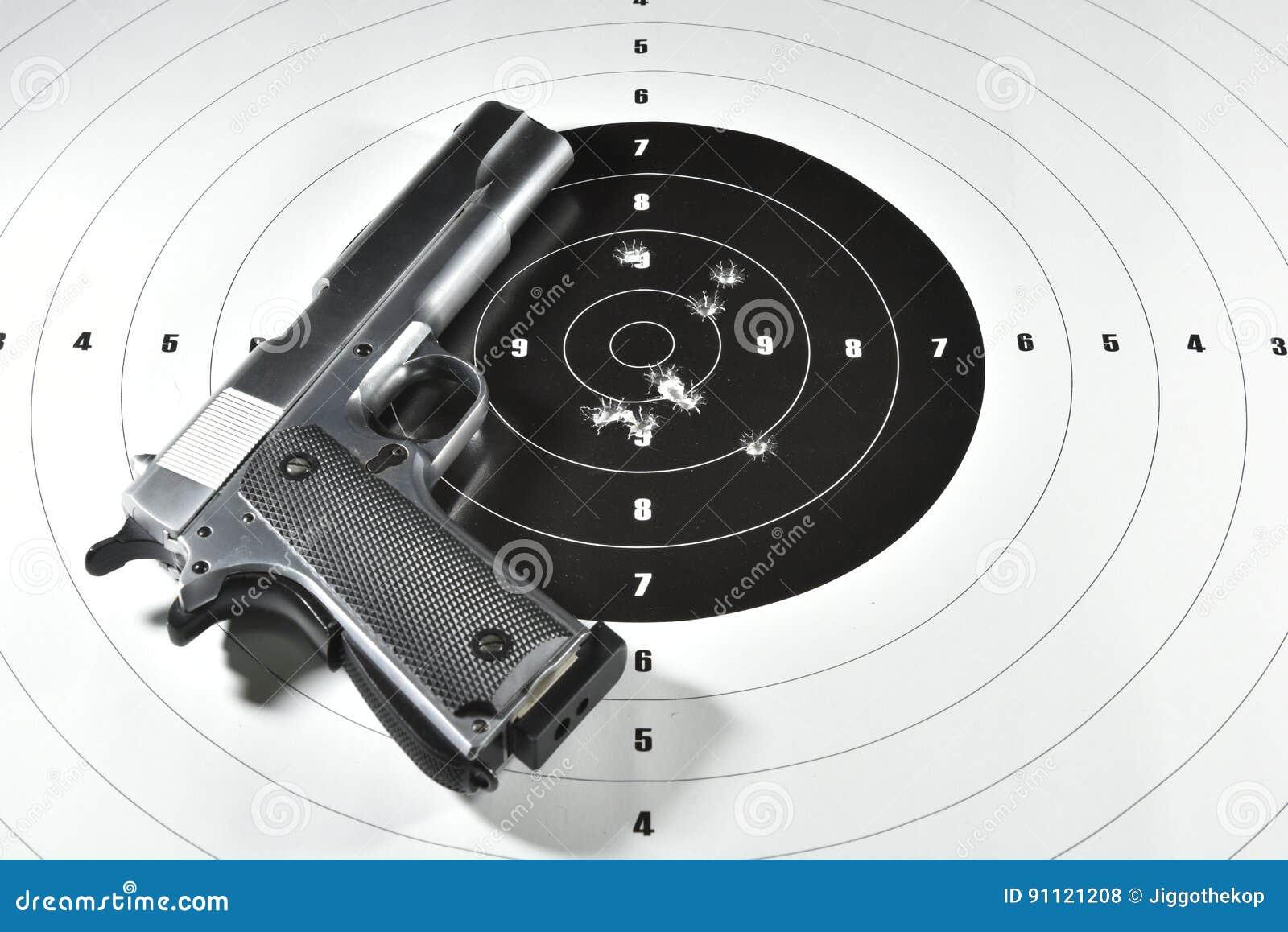 Handgun And Shooting Target Stock Photo - Image of military