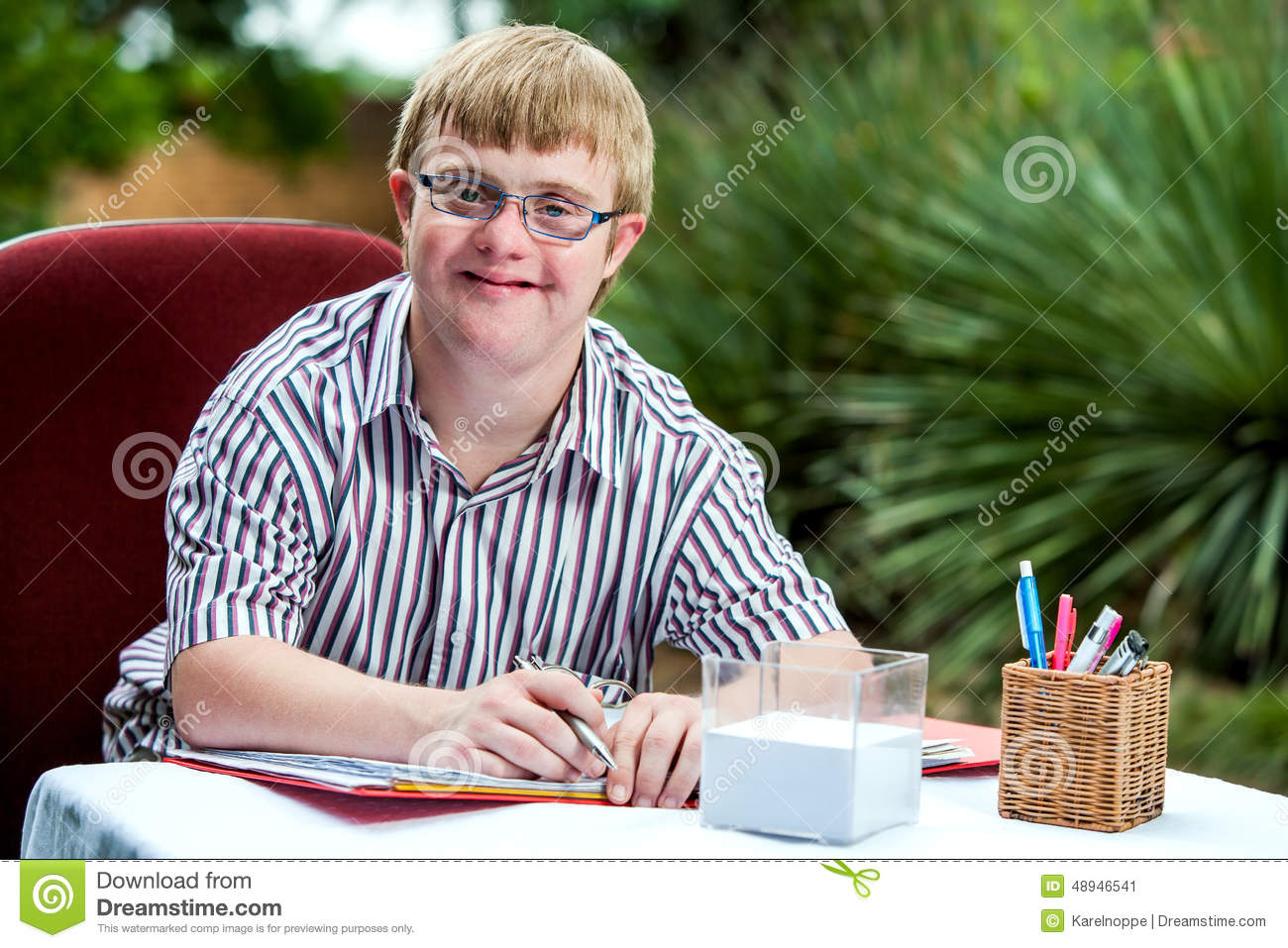 Handicapped Boy At Desk In Garden Stock Photo Image 48946541