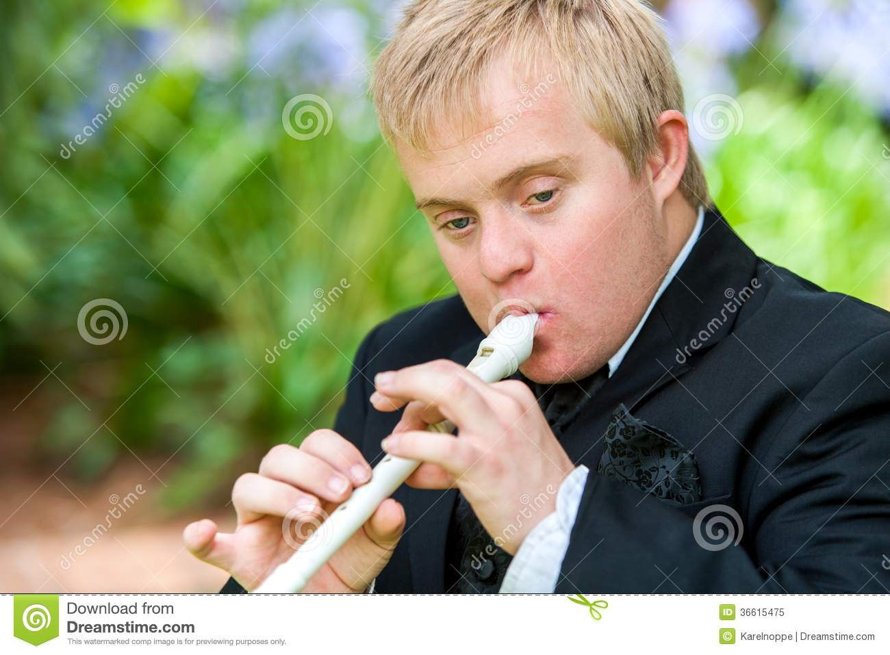Handicapped Boy Playing Block Flute. Royalty Free Stock Photo - Image ...