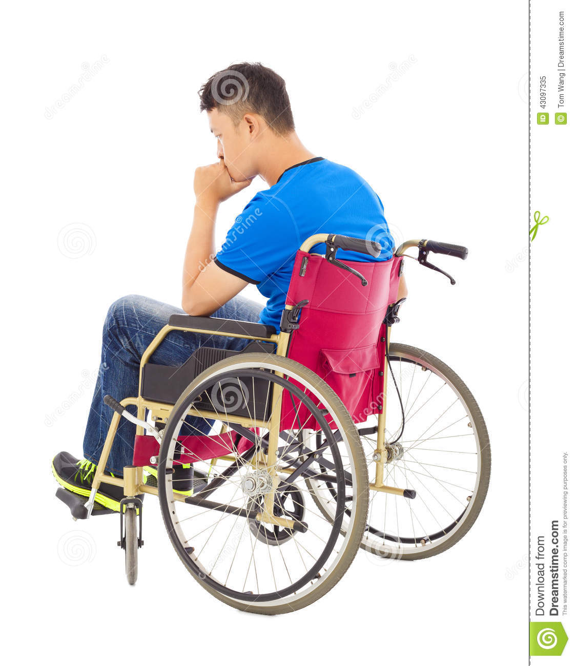 Handicapped Man Sitting On A Wheelchair And Thinking Stock