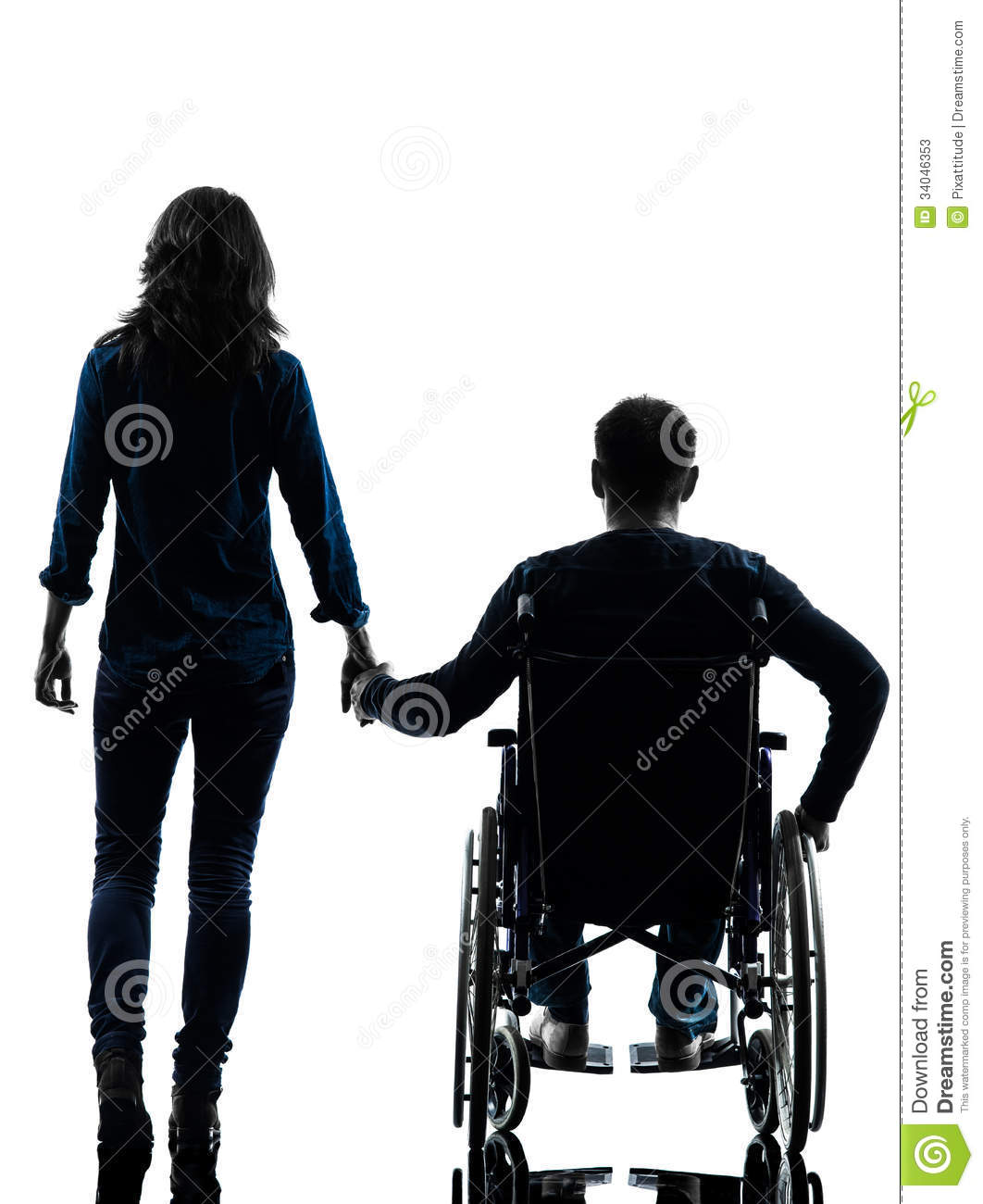 Handicapped man in wheelchair and woman holding hands Handicapped wheelchair