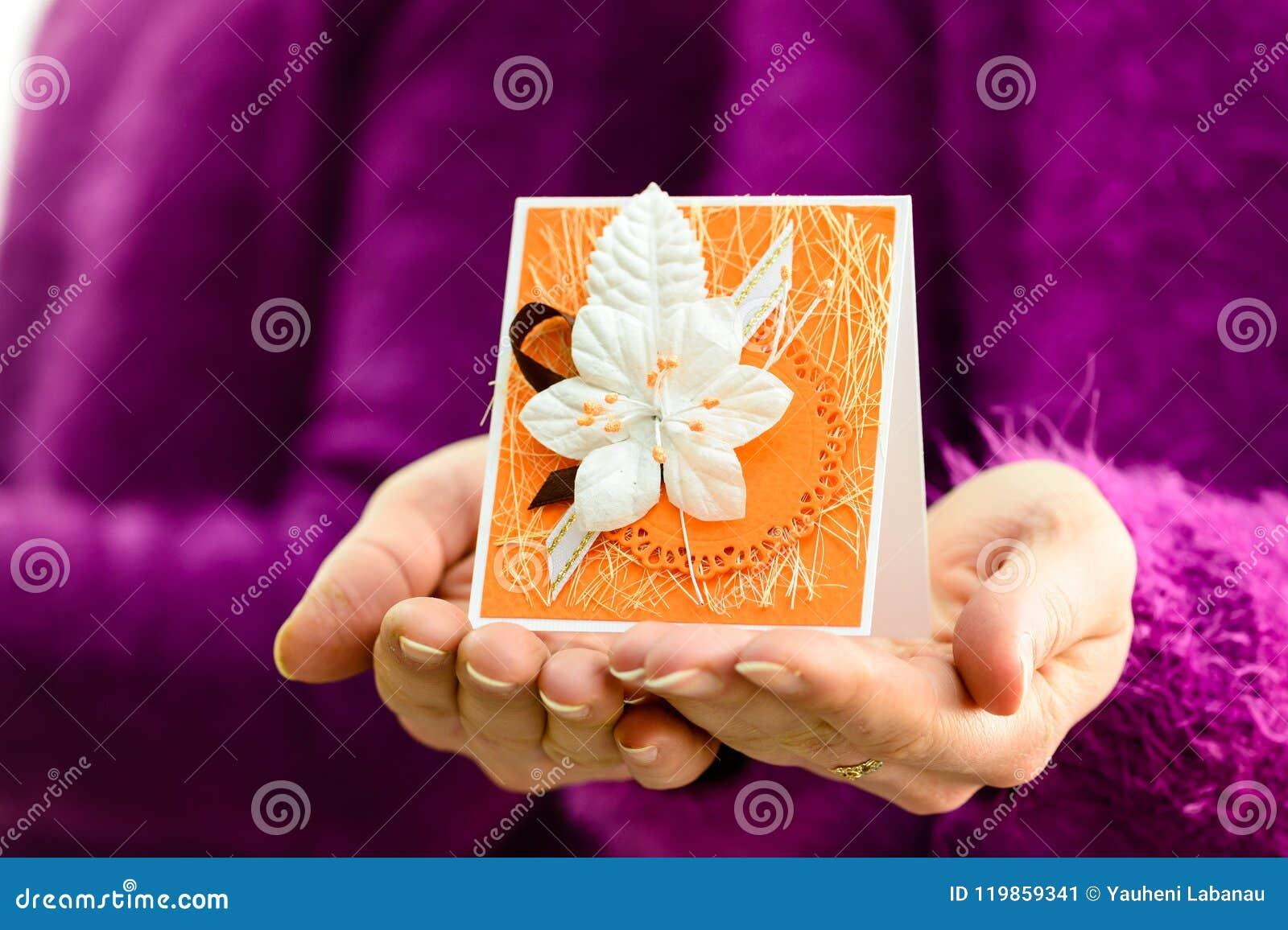 Handmade birthday card in woman hands