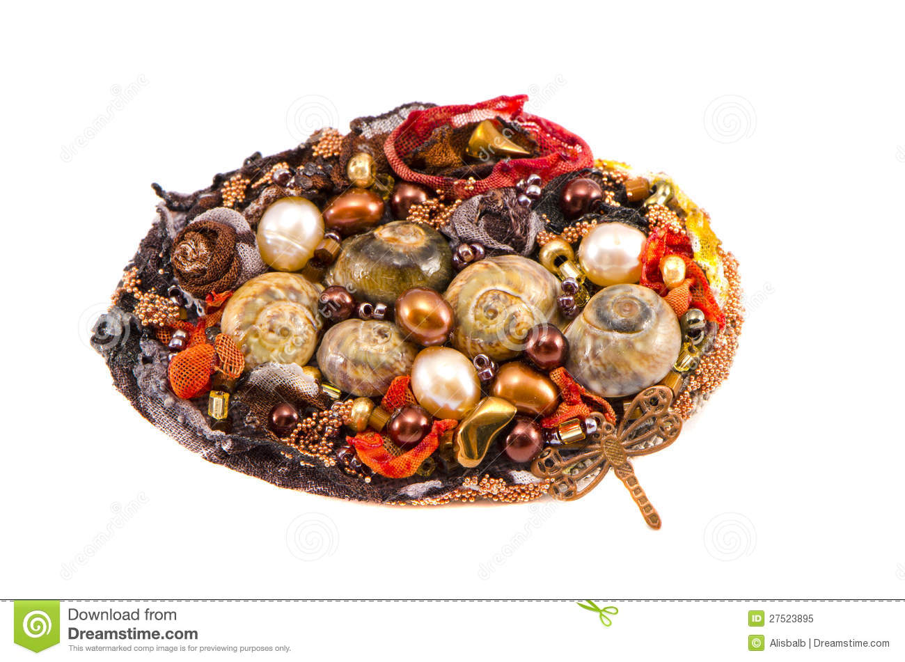 handmade brooch with various stones and shells