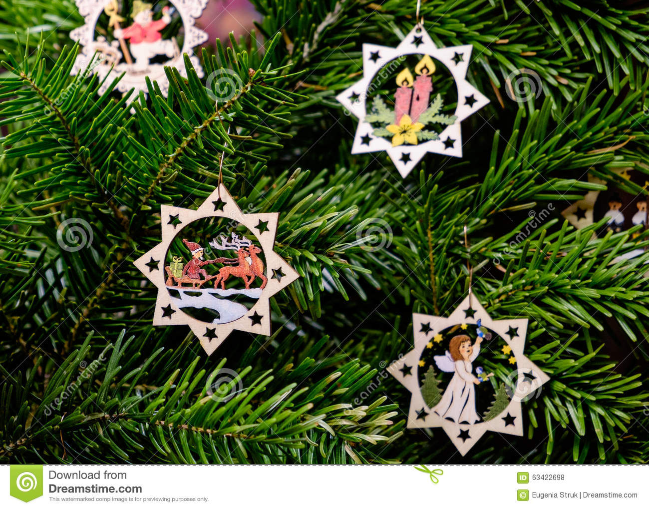 Handmade carved wooden christmas decorations on a tree at the ch