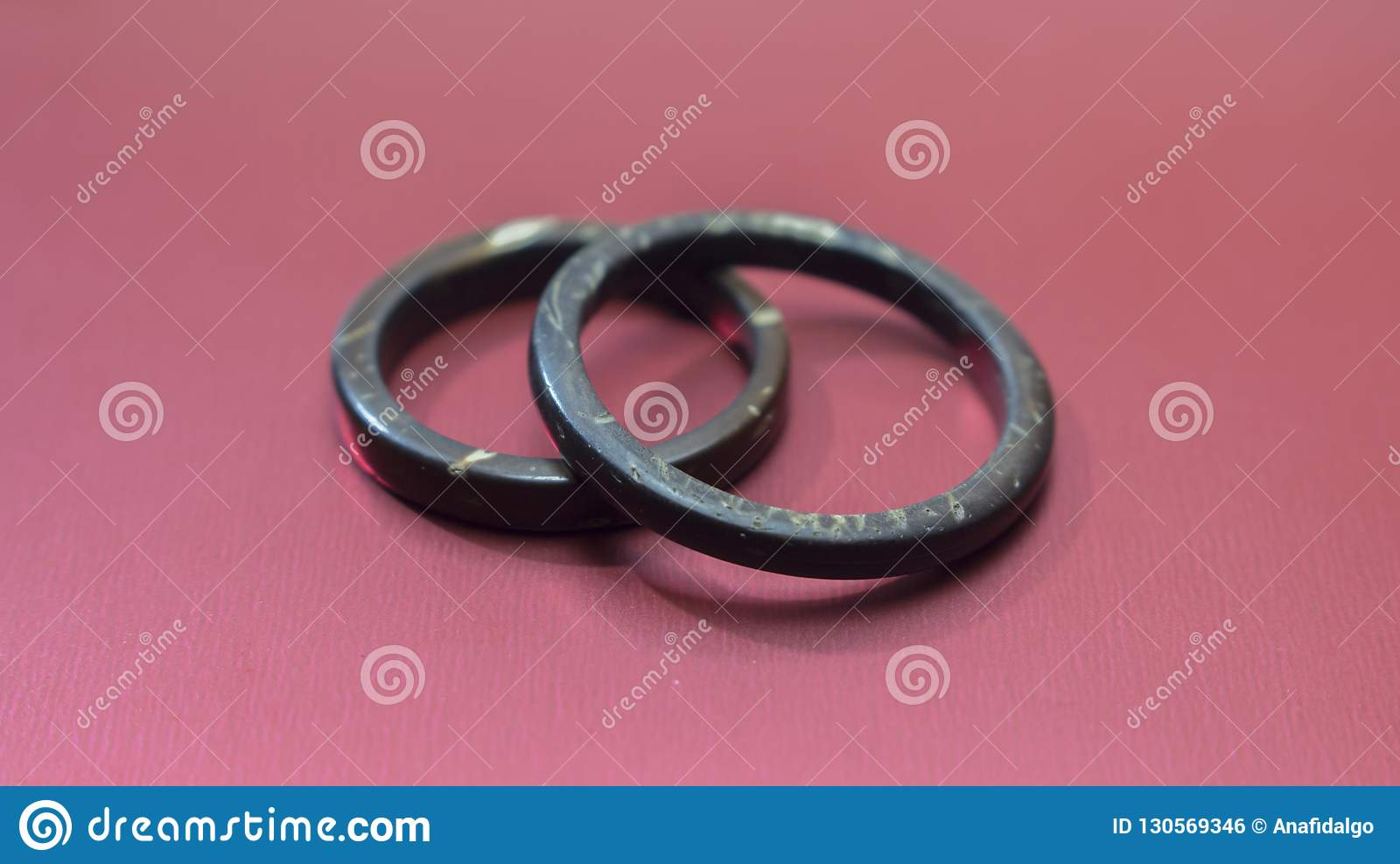 Handmade Coconut Rings With Imperfections In Red Background Artisan