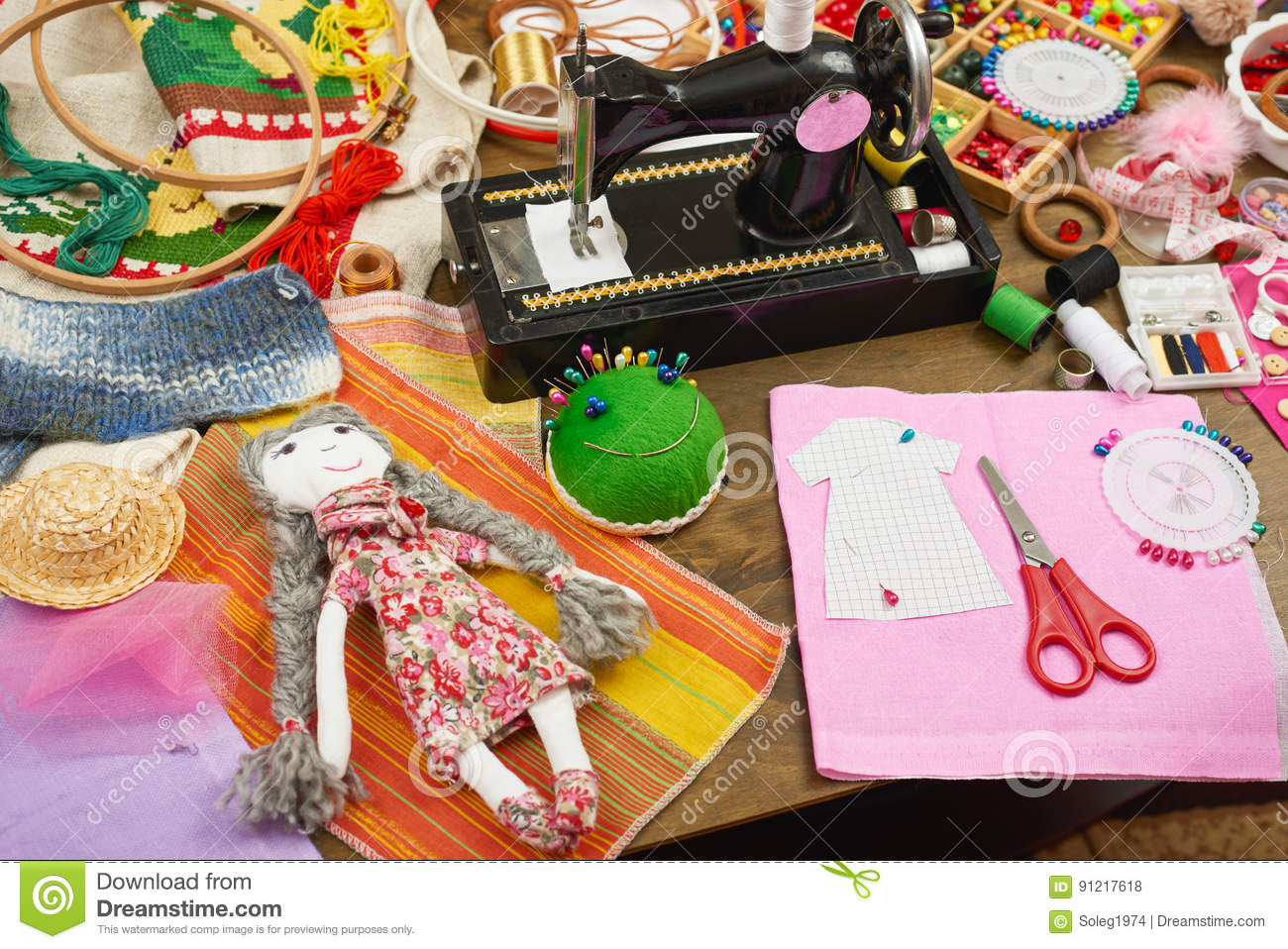 Handmade doll and clothing pattern, sewing accessories top view, seamstress workplace, many object for needlework, embroidery and