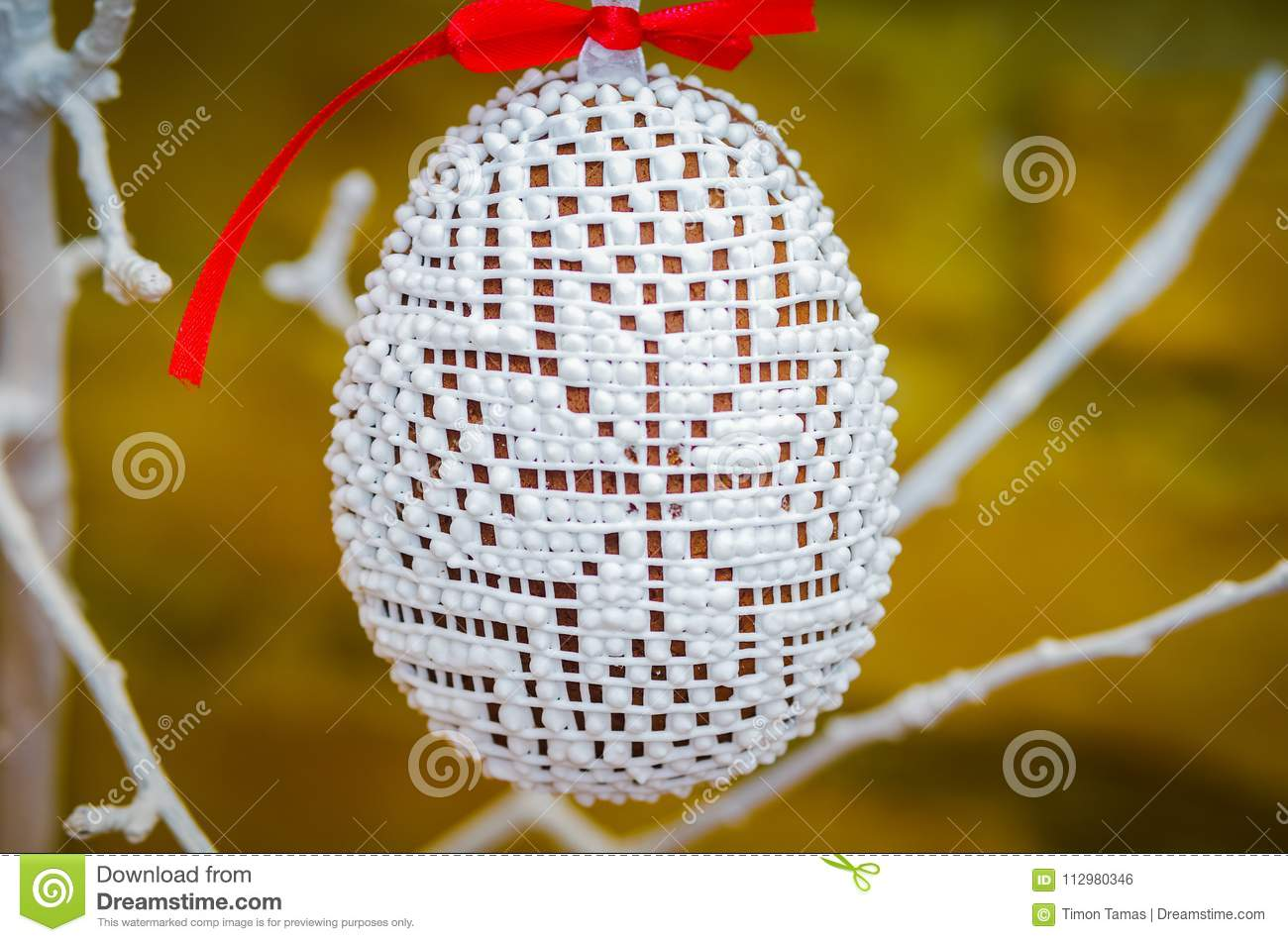 Handmade easter egg decoration with green leaves