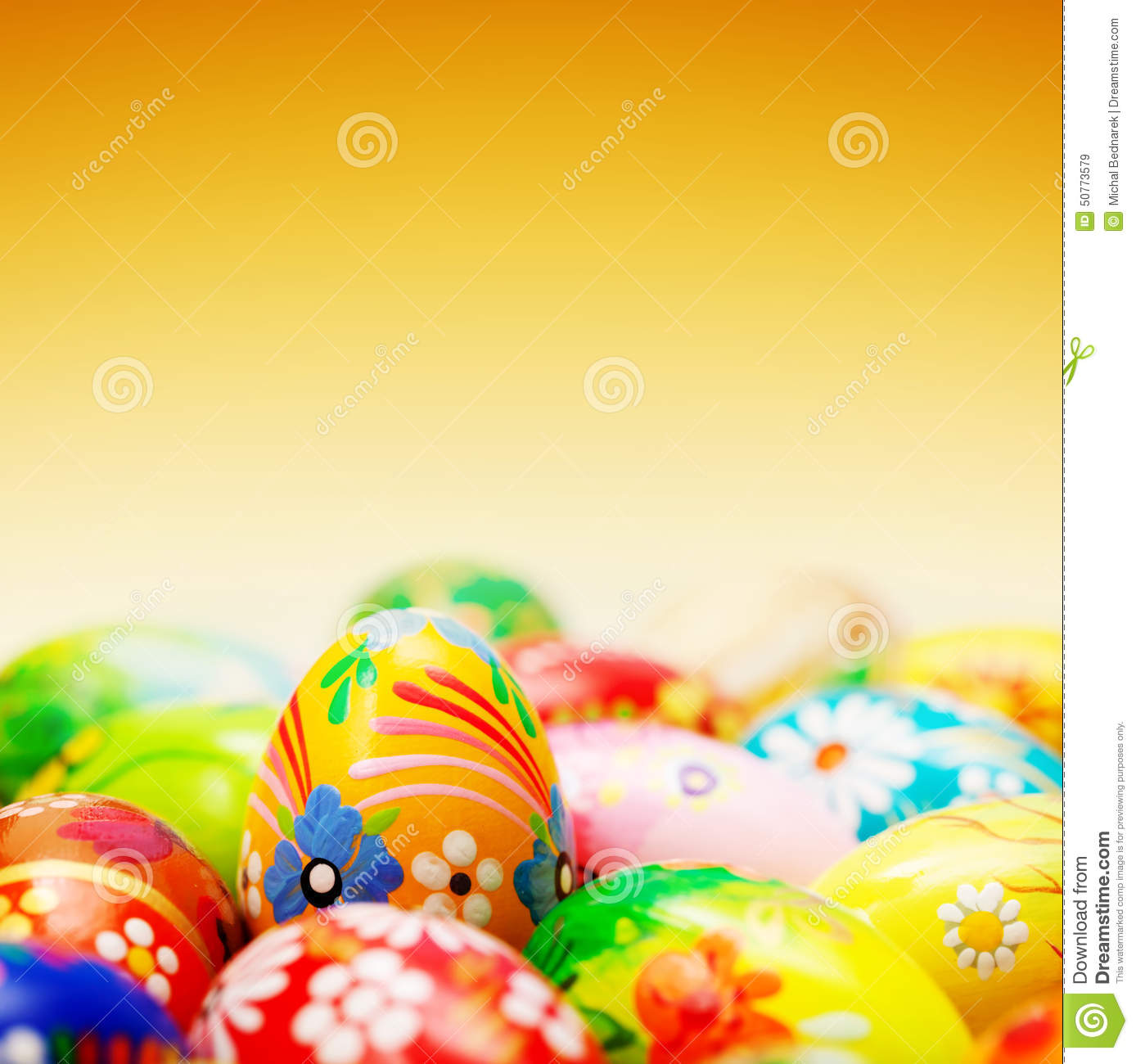Handmade Easter eggs on yellow background. Spring patterns