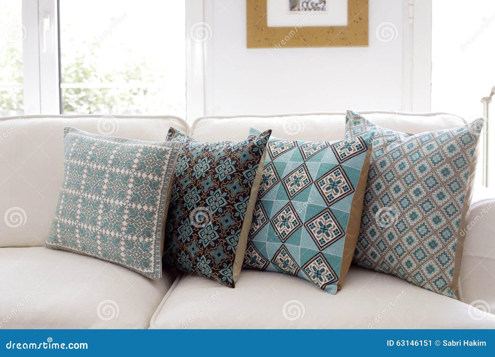handmade embroidered pillows on sofa stock photo - image: 63146151