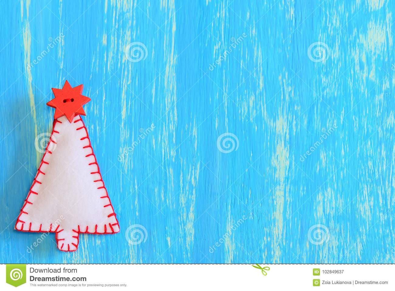 Handmade Felt Christmas Tree On A Blue Wooden Background With Copy ...