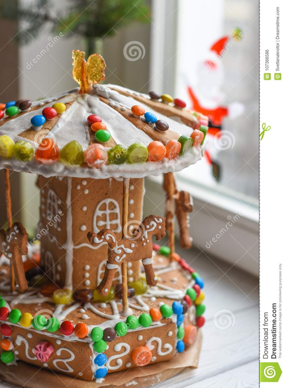 download a gingerbread carousel and some christmas decoration elements on a white wooden surface stock photo - Christmas Carousel Decoration