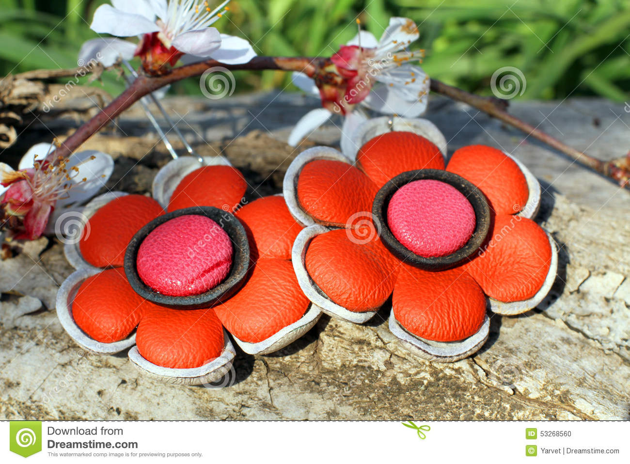 Handmade leather earrings on the nature background