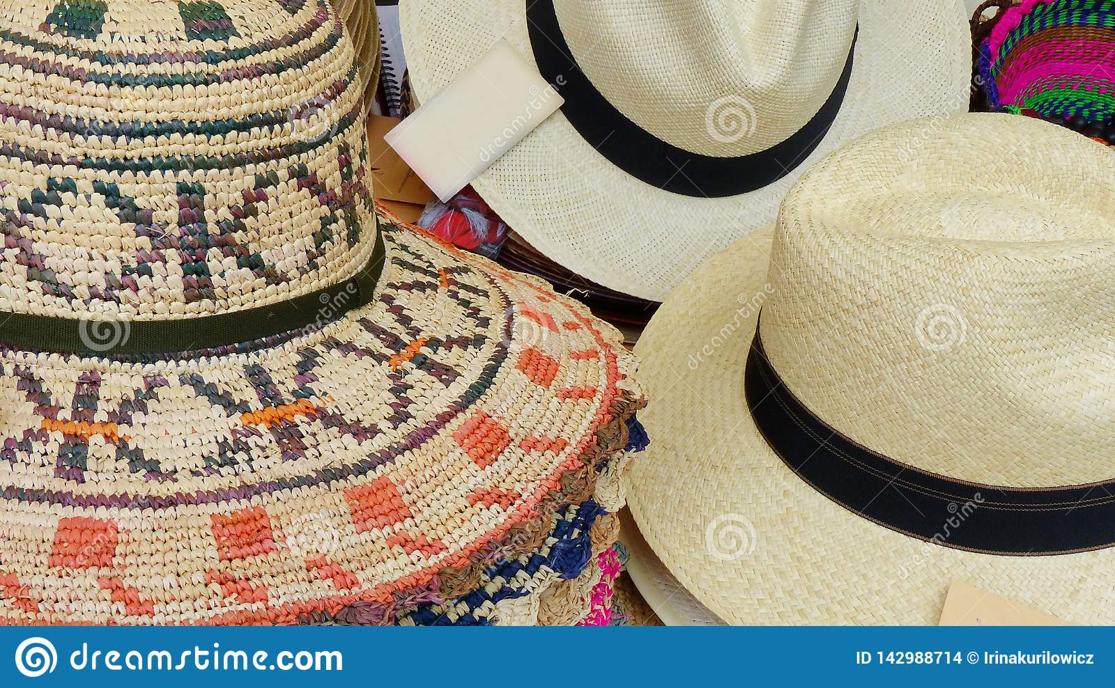 995478fcc8f1f Colorful Handmade Panama Hats or Paja Toquilla hats or sombreros made with  straw at the traditional outdoor market in Cuenca, Ecuador.