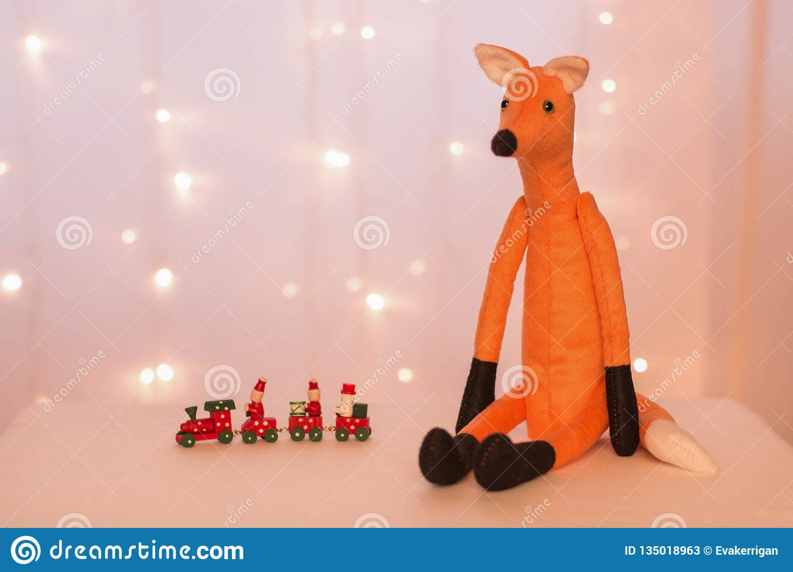 Christmas Kangaroo Lights.Handmade Red Fox Sitting On The Background Of Christmas