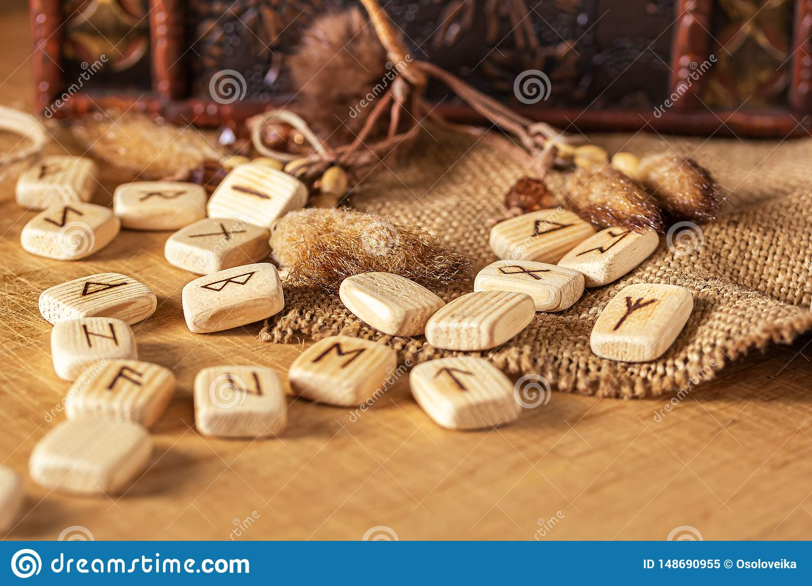 Handmade scandinavian wooden runes on a wooden vintage background. Concept of fortune telling and prediction of the