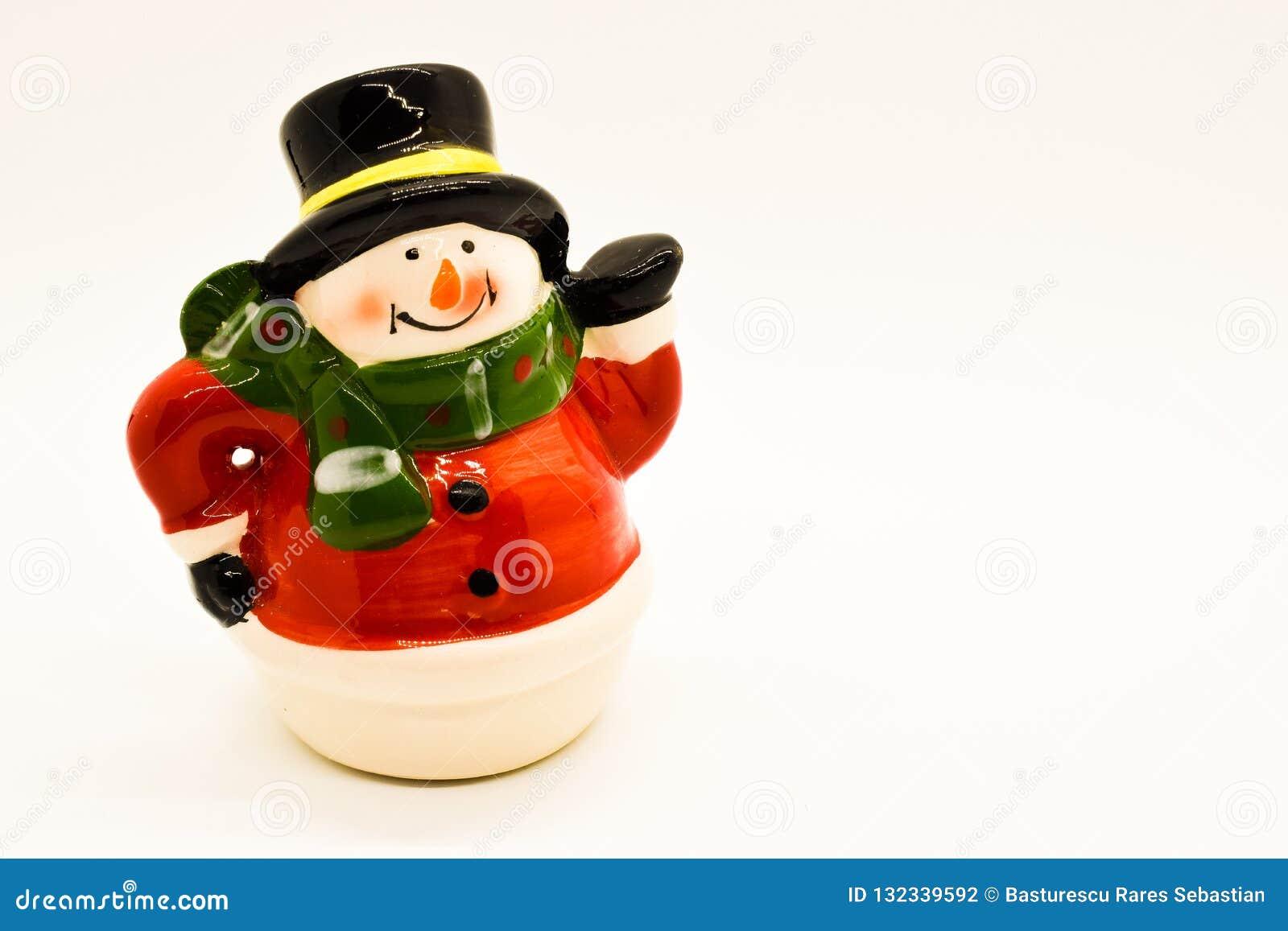 Handmade snowman figurine isolated on white background. Christmas decoration.