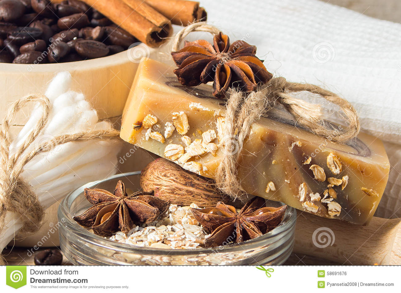 Handmade soap with coffee beans and spices on a wooden backgroun