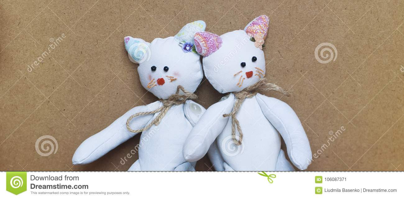 Twin toy cats