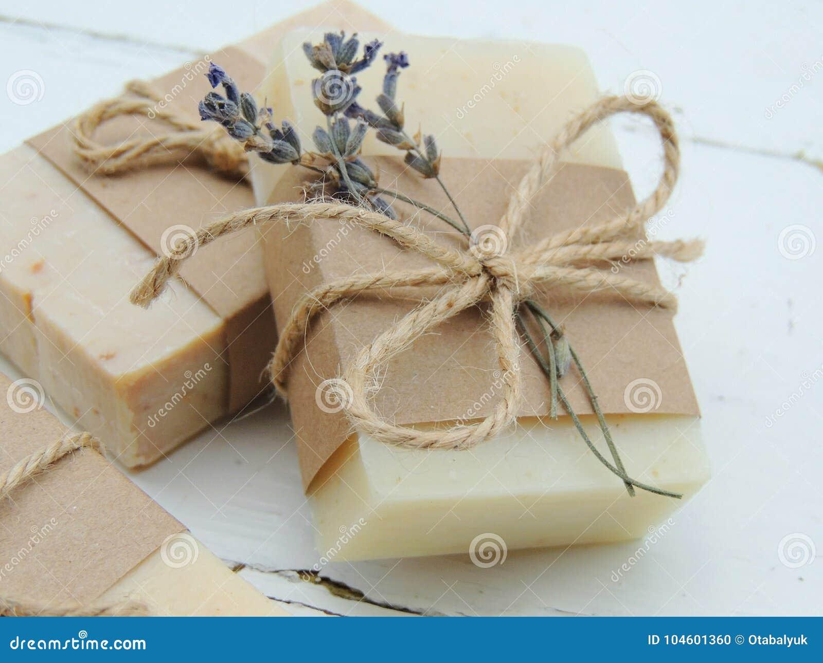 Handmade spa lavender soap on vintage wooden background. Soap making. Soap bars.