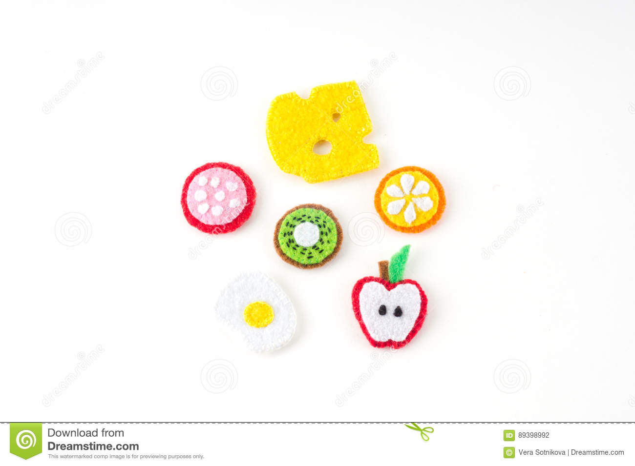 Handmade toy in the form of fruits and food made of felt . Close