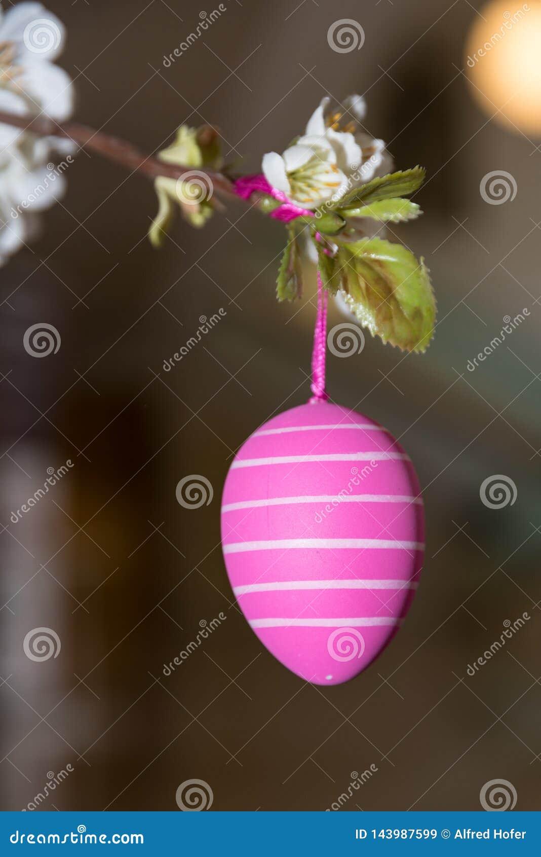 Handpainted pink Easter egg - closeup