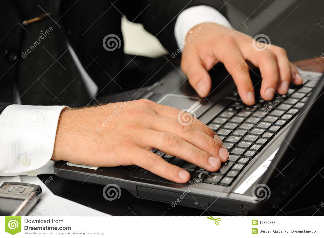 Hands above the keyboard laptop