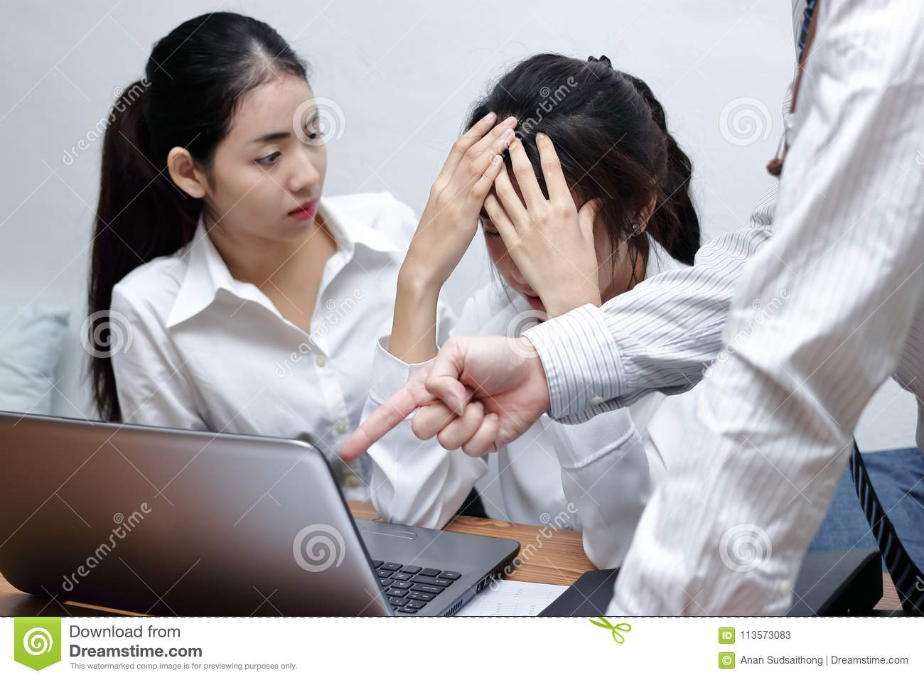 Hands of angry male boss pointing fingers and blaming young Asian employee  in office.