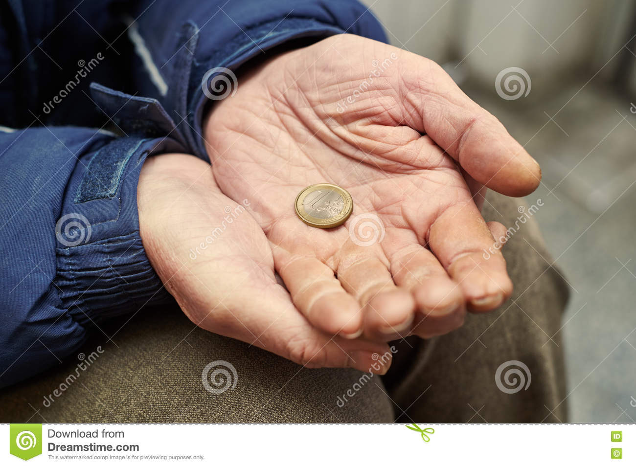 hands of beggar with one euro coin begging for money stock