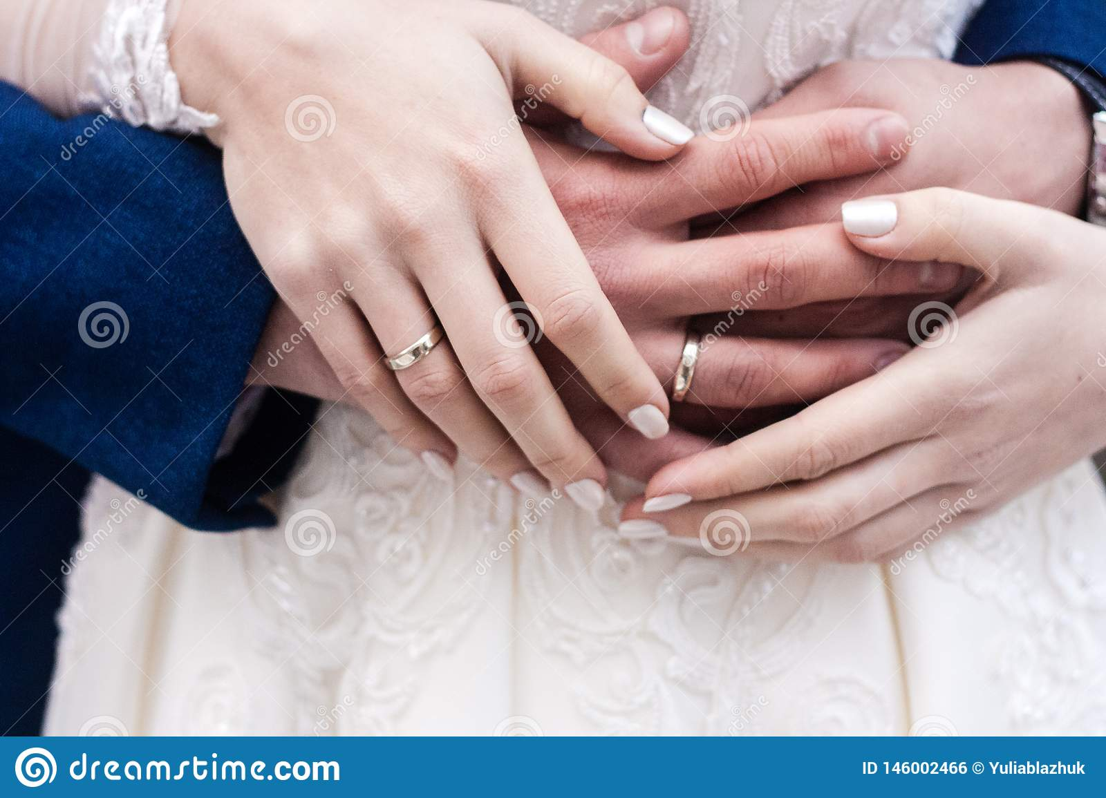 Hands of bride and groom with rings close up