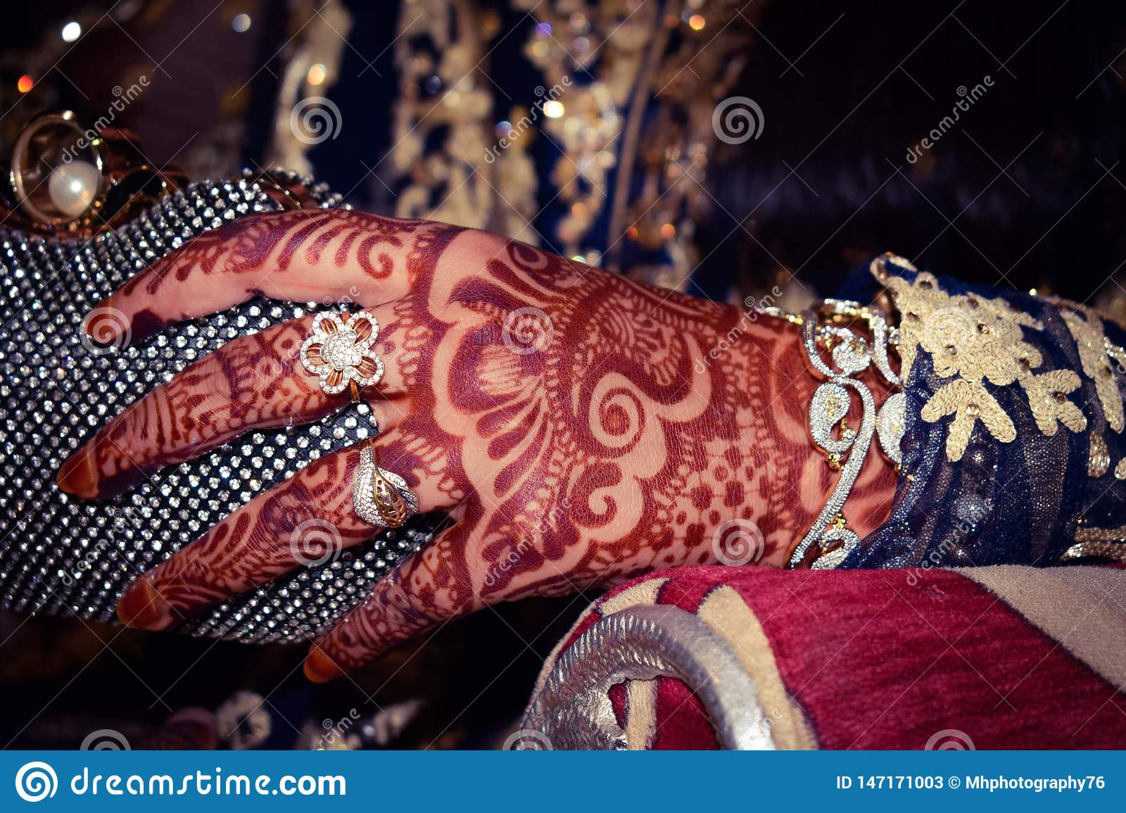 Hands of the bride with heena and gold ornaments. Indian marriage and Pakistani are expensive.
