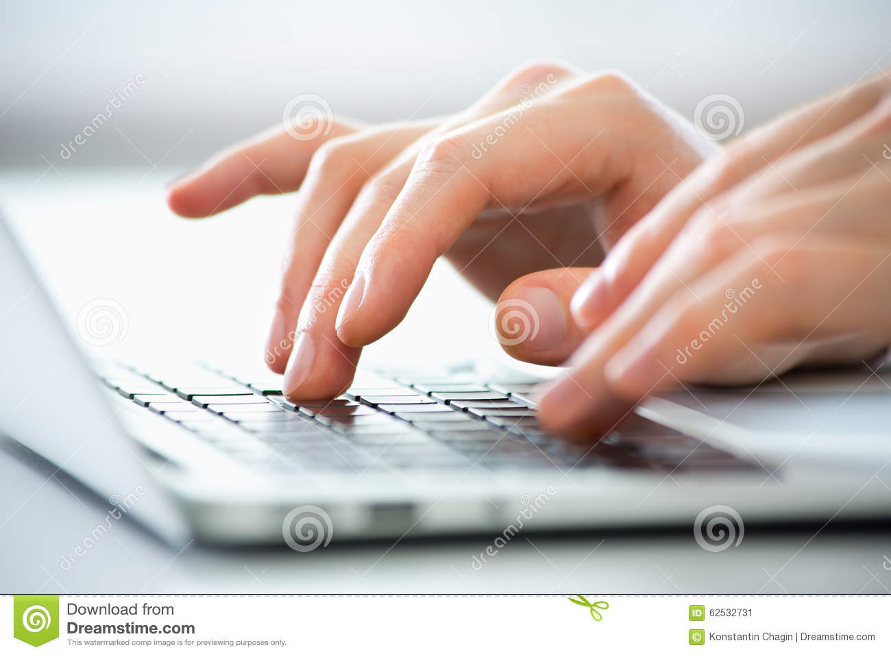 Hands of business man typing on a laptop.