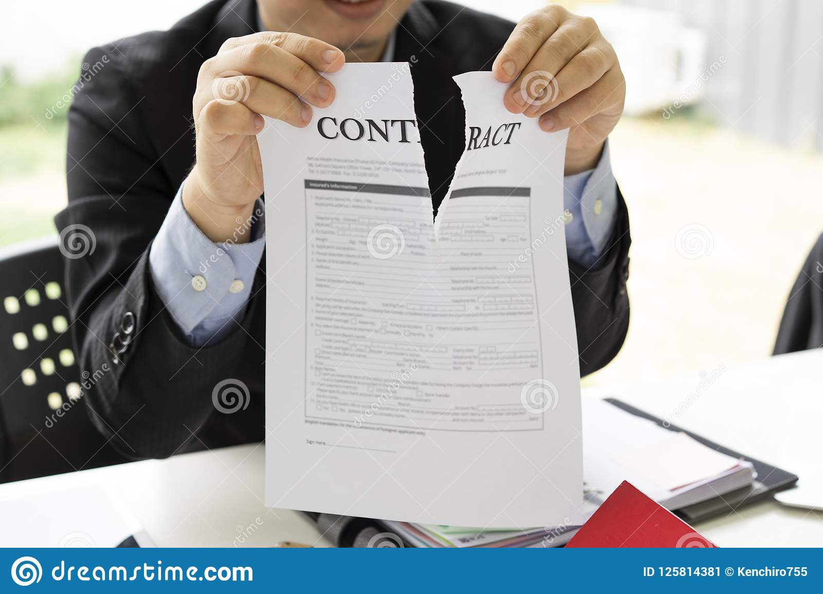 Hands of businessman ripping contract agreement paper,contract canceled,