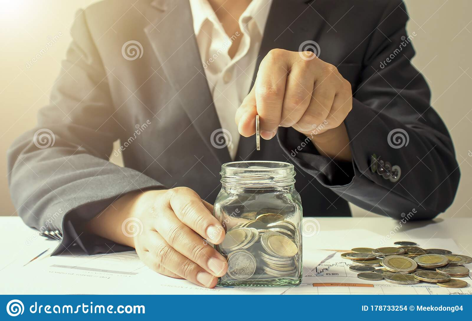 The Hands Of A Businesswoman Who Put Coins In A Jar To Save Money Stock Photo Image Of Growth Cash 178733254
