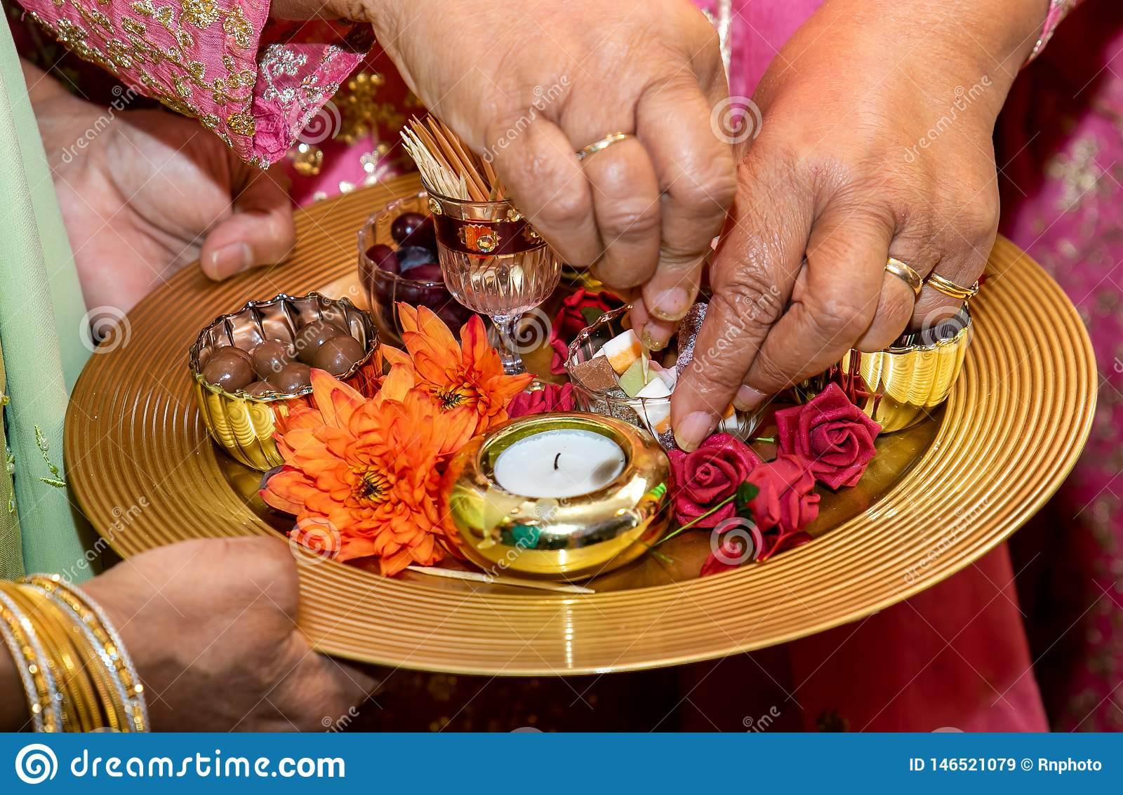 Hands and candles for mendhi henna wedding