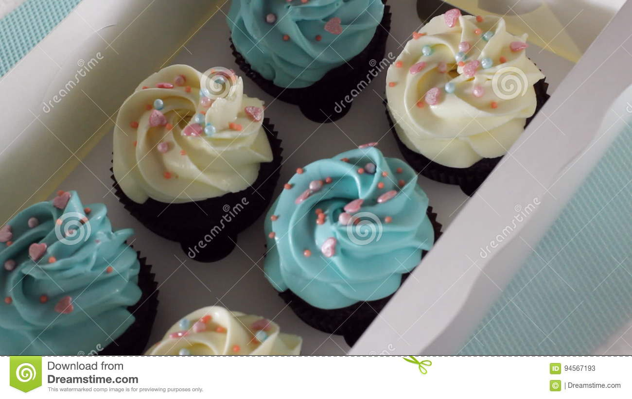 hands close a box of cupcakes. hd stock video - video of diet