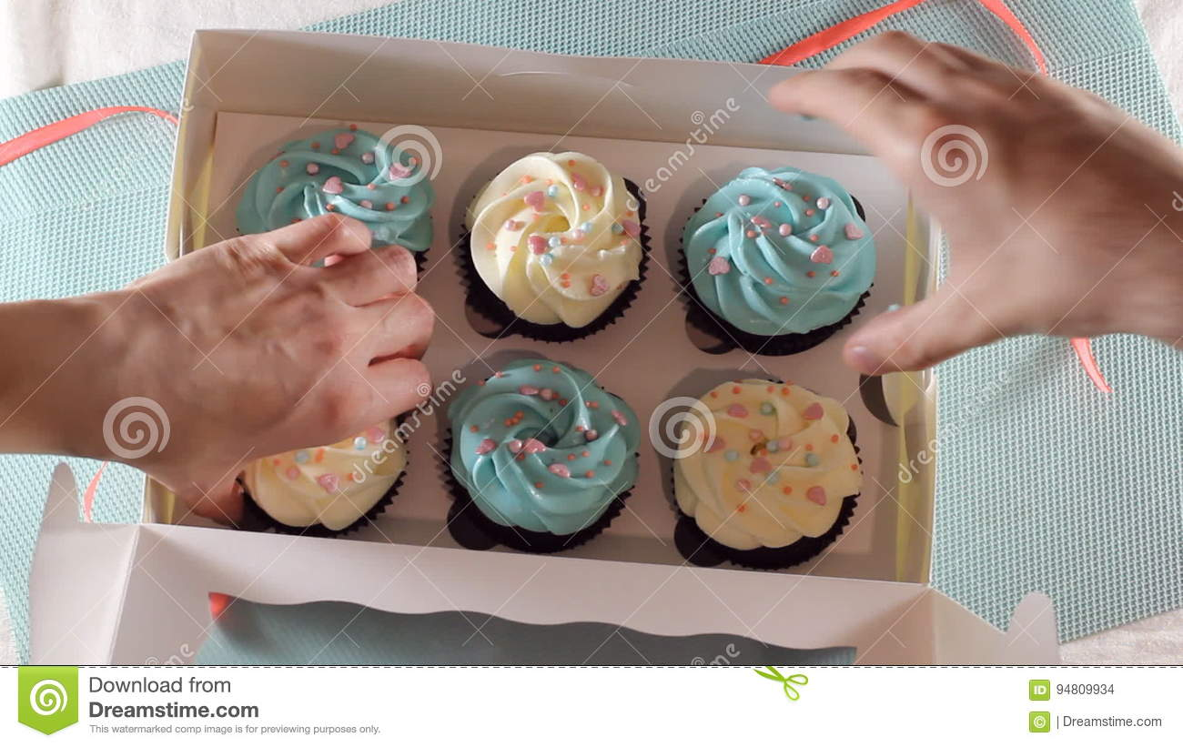 hands close a box of cupcakes. hd stock footage - video of birthday