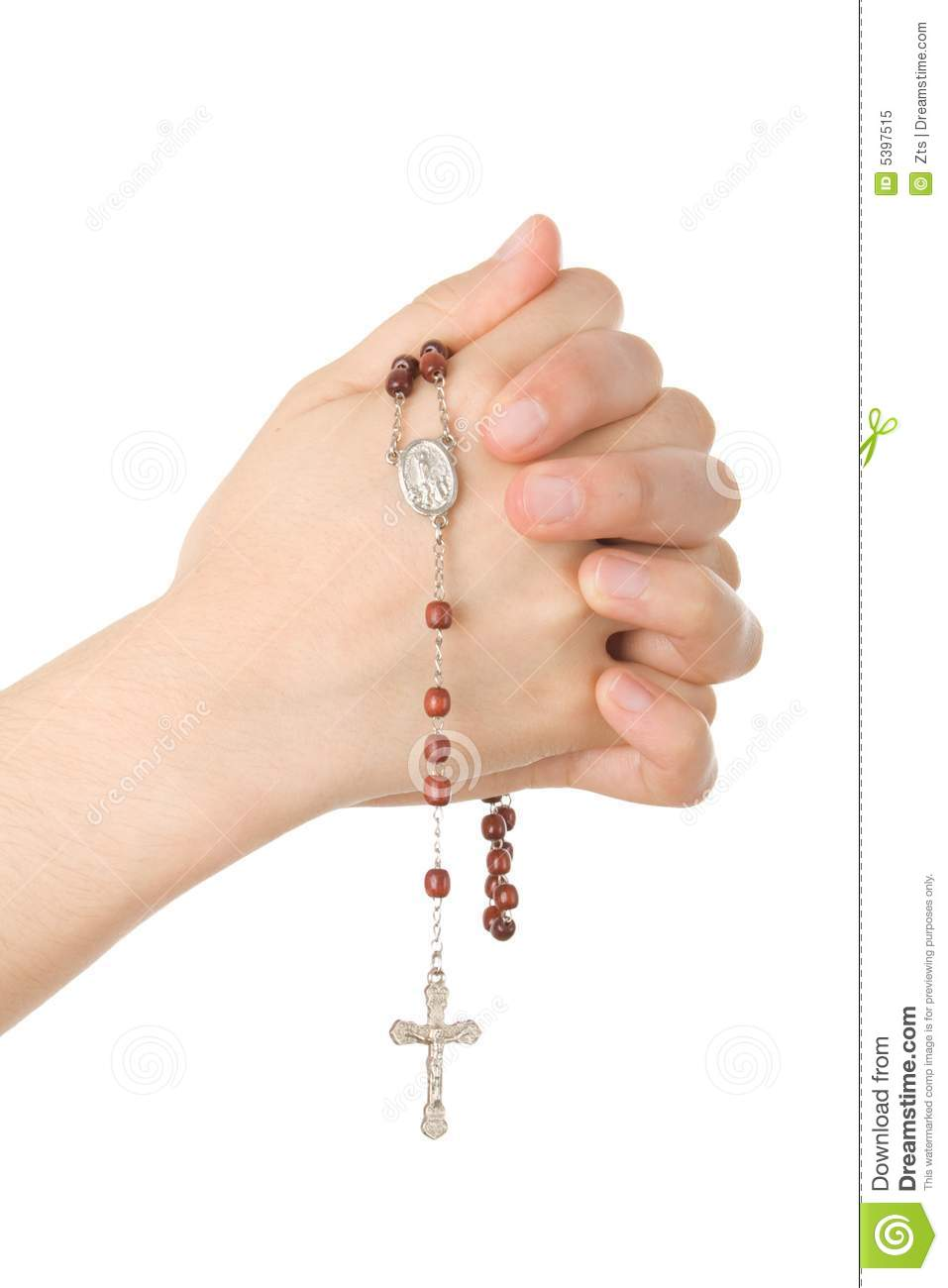 hands closed in prayer with a rosary royalty free stock