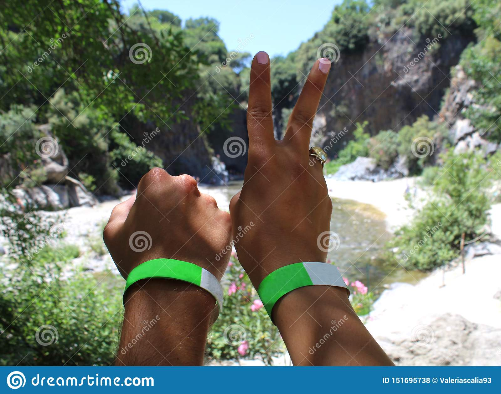The hands of a couple of young traveler at a river gorges park