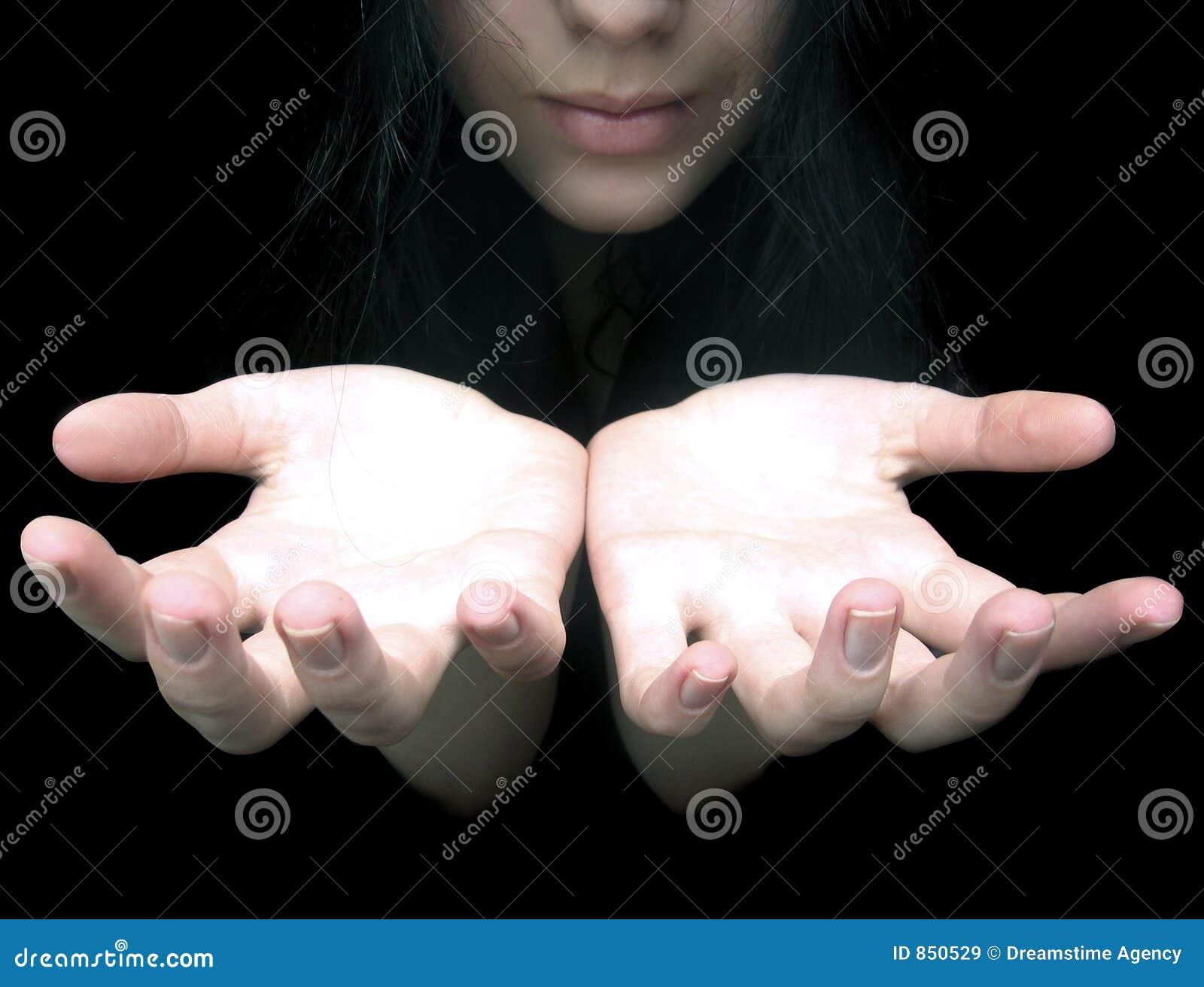 Hands in darkness