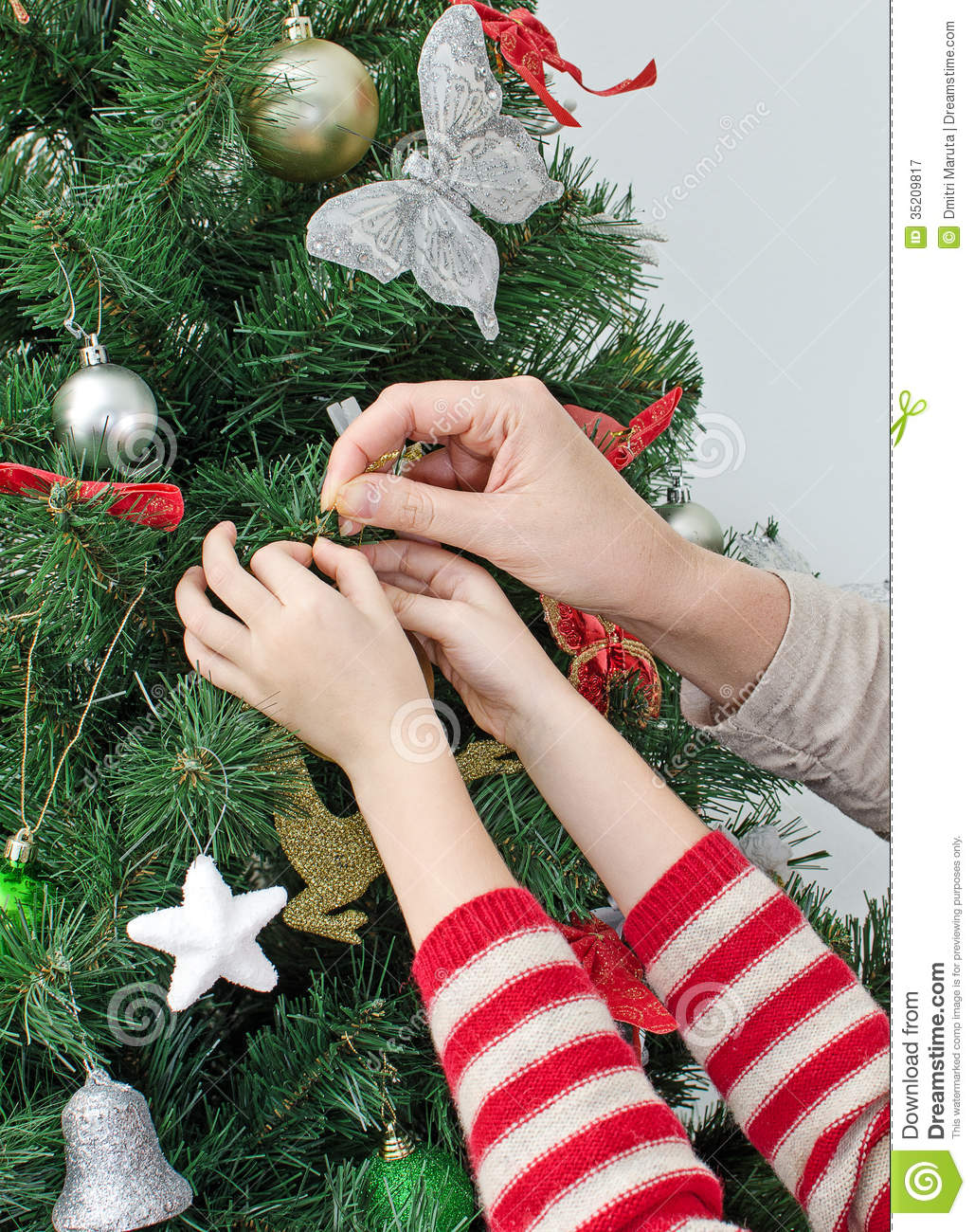 Hands Decorating The Christmas Tree Royalty Free Stock Photography ...