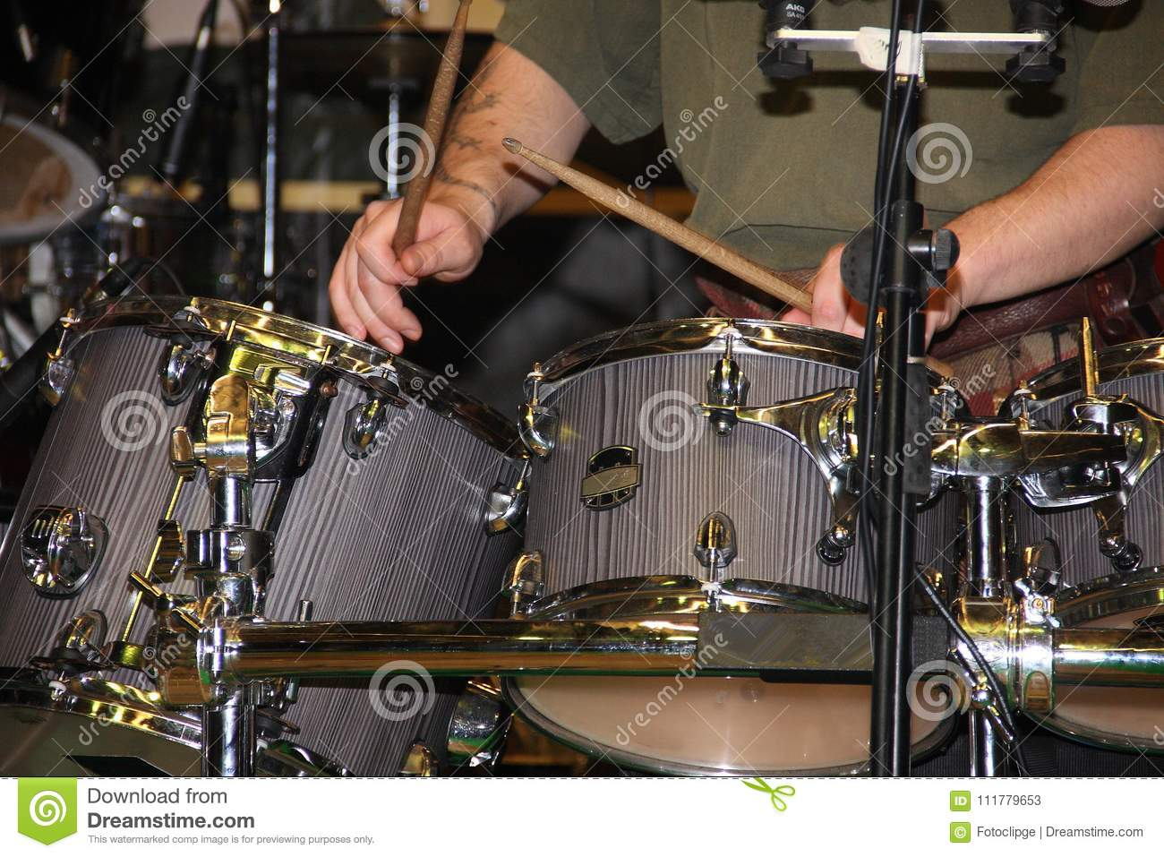 The hands of the drummer at work during the concert