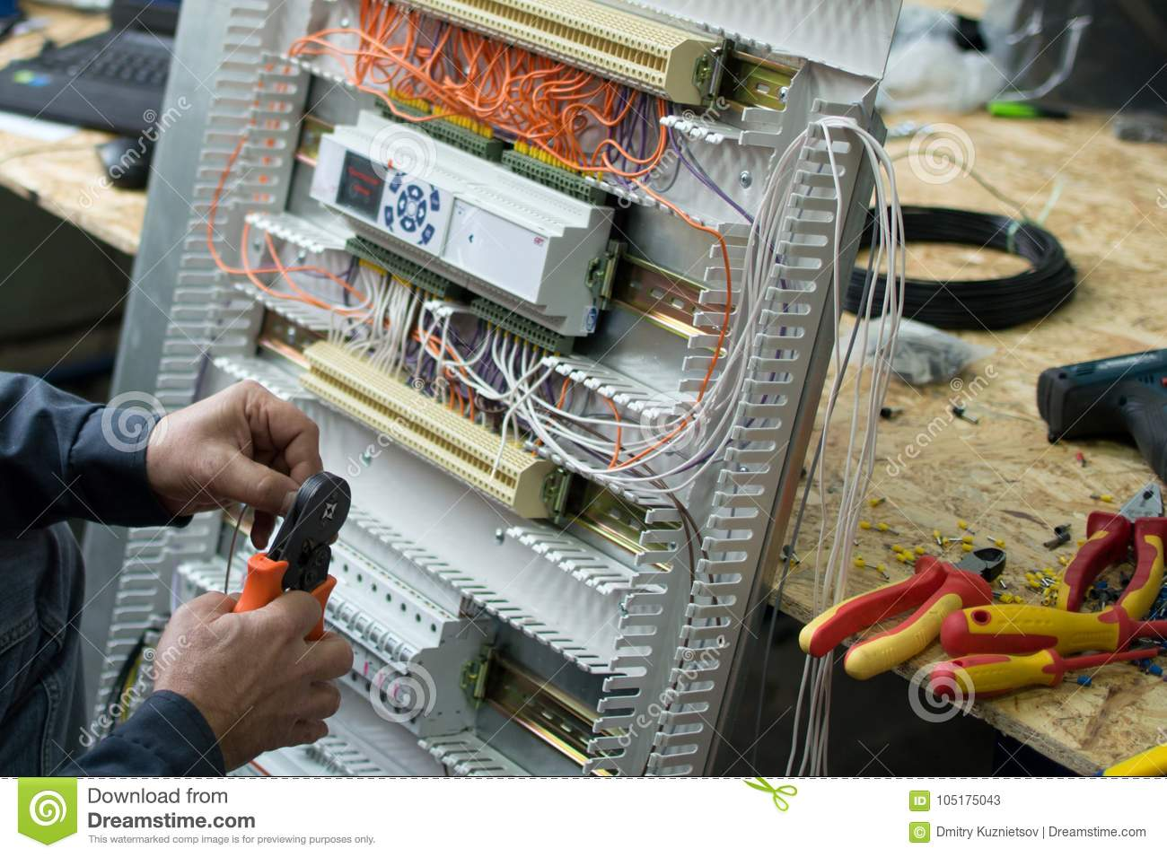 Hands Of Electrical Technician Assembling Low Voltage Industrial Home Wiring Hvac Control Cubicle In Workshop Close