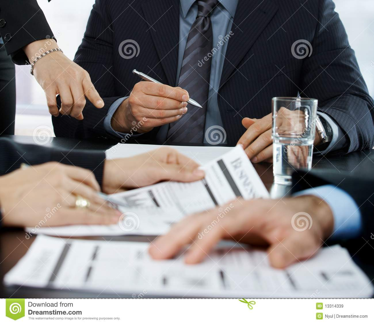 Hands in focus at business meeting