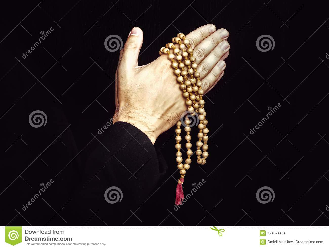 Hand with a rosary isolated on white background