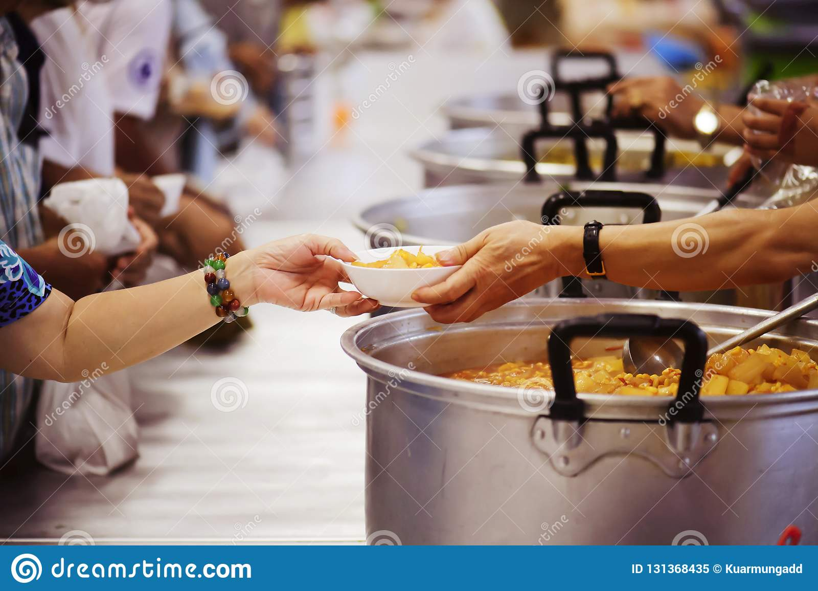 The hands of the poor receive food from the hands of the philanthropist : concept of giving
