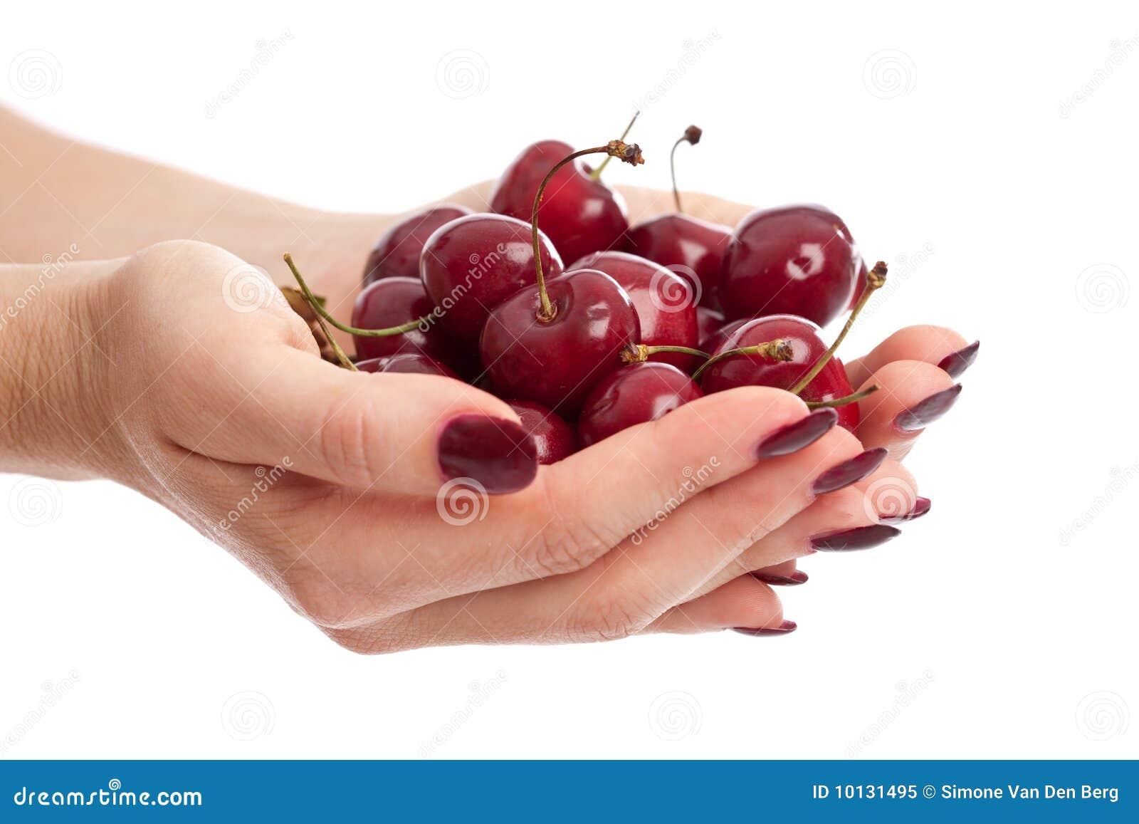 Hands ful of fresh berries